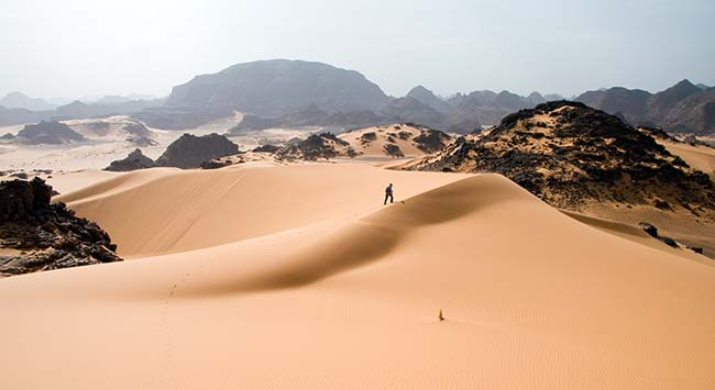 Hiker in the Tadrart Acacus (part of the Sahara Desert) in Western Libya